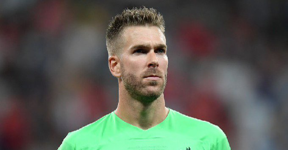 Liverpool goalkeeper Adrian harmed by a fan on the pitch