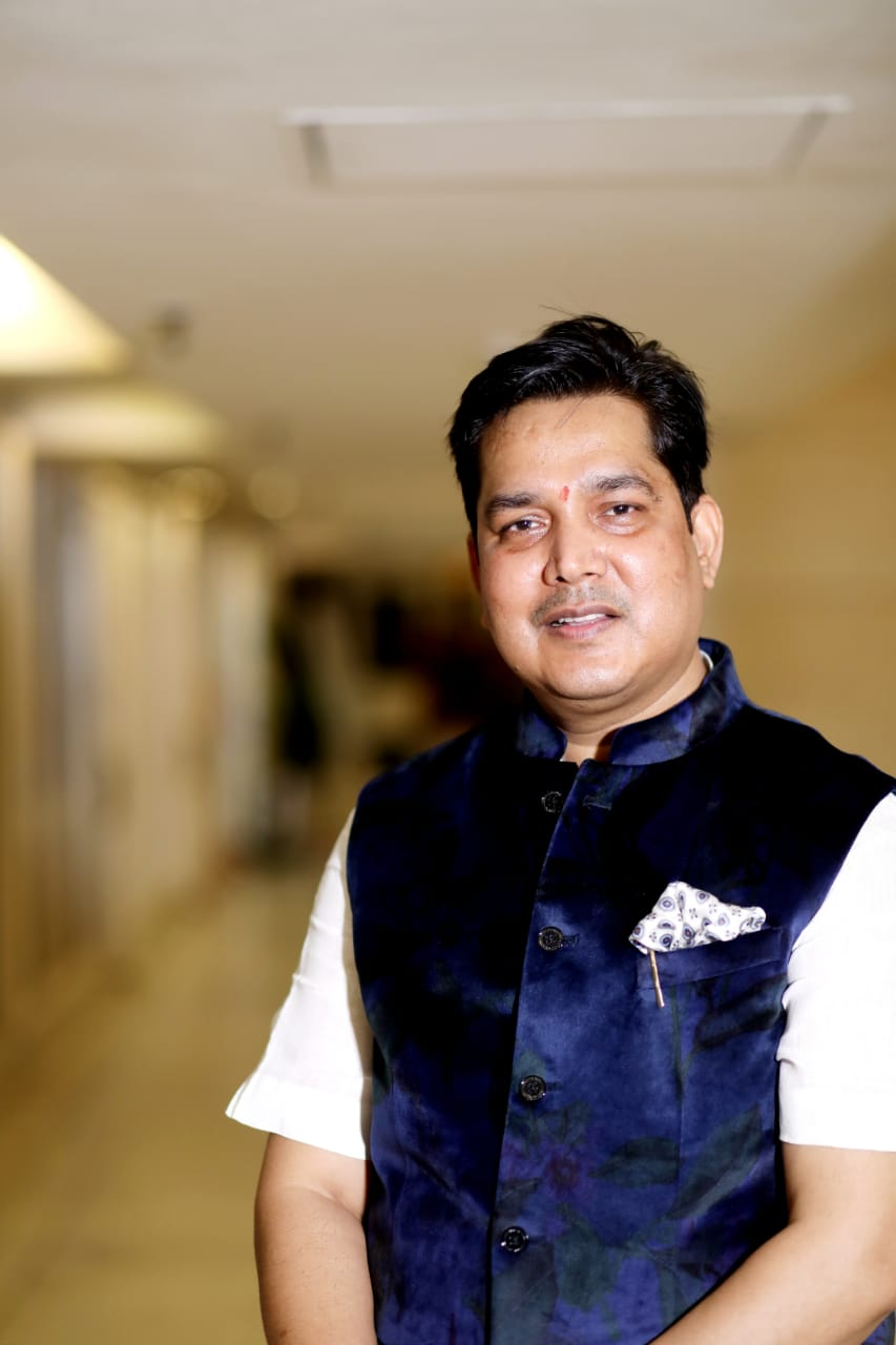 Creating a positive impact on people's lives through his knowledge and expertise in astrology is Dr. Acharya Vinod Kumar Ojha.